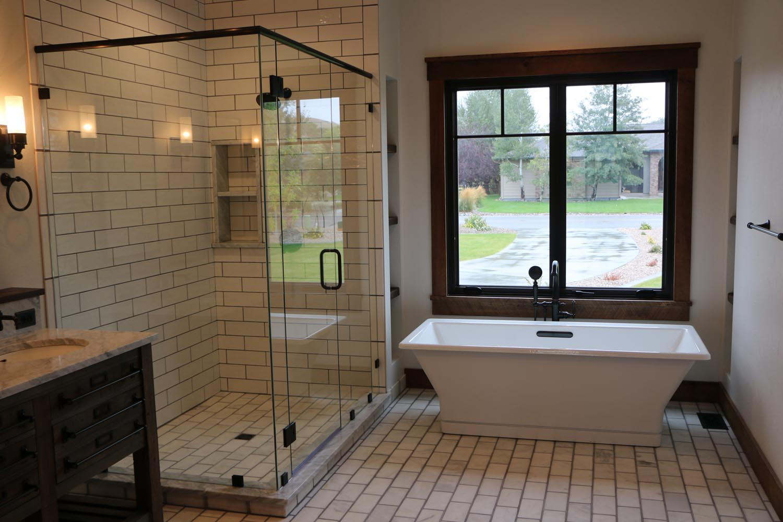 24 Master Bathroom With Cast Iron Soaker Tub Custom Glass Shower Tumbled Marble Floors Heritage Woodworks